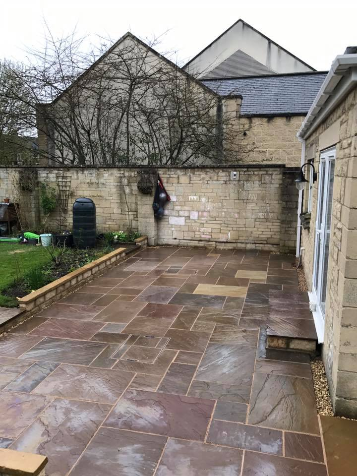 Completed patio with white stone extension and UPVC french doors Turfing, Landscaping design, paving and walls, decking, block paving and driveway, planting, ponds and water features, gates and fences, garden sheds, patios and terraces in Calne, Devizes