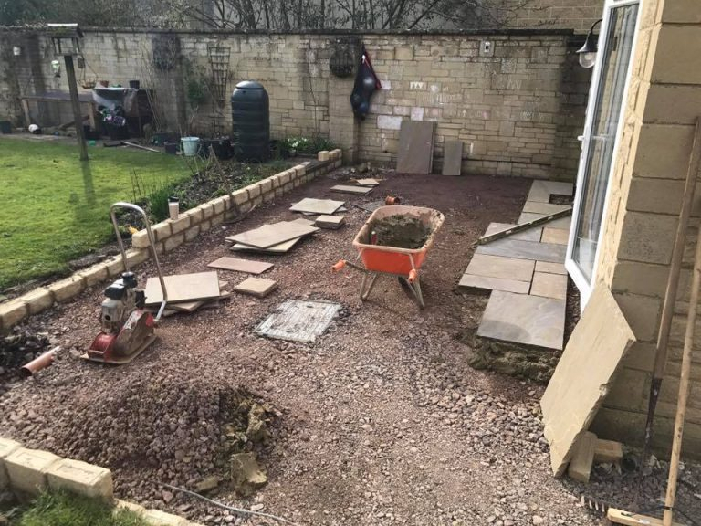 In progress patio with white stone extension and UPVC french doors Turfing, Landscaping design, paving and walls, decking, block paving and driveway, planting, ponds and water features, gates and fences, garden sheds, patios and terraces in Calne, Devizes