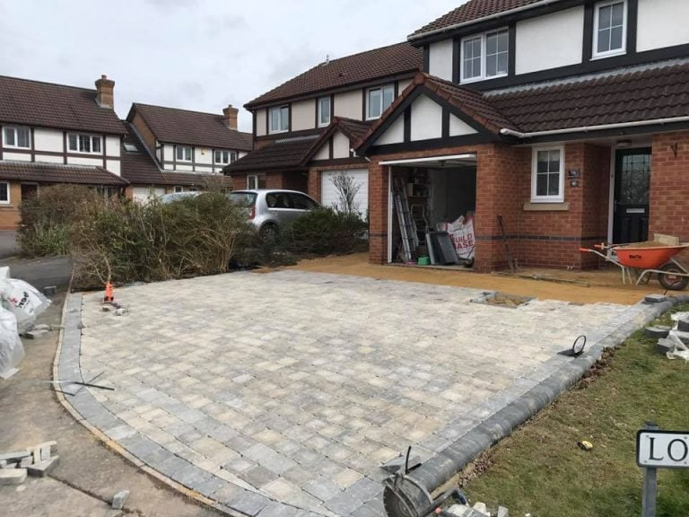 Stone driveway paving in progress with modern building and garage, Turfing, Landscaping design, paving and walls, decking, block paving and driveway, planting, ponds and water features, gates and fences, garden sheds, patios and terraces in Calne, Devizes